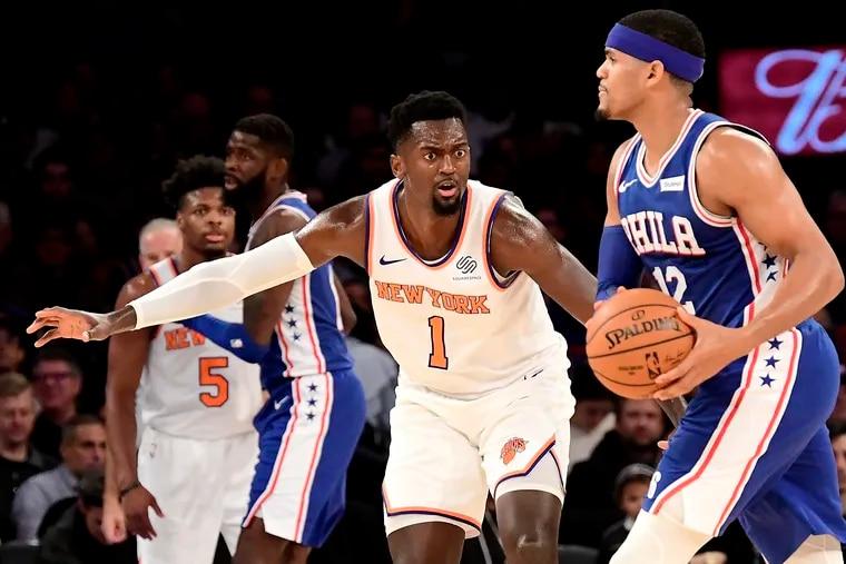 New York Knicks forward Bobby Portis (1) defends against Philadelphia 76ers forward Tobias Harris (12) during Friday's matchup at Madison Square Garden.