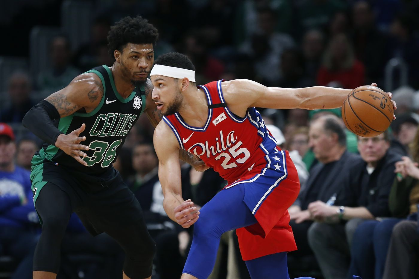 76ers guard Ben Simmons (25) tries to drive against Boston's Marcus Smart during the first quarter.