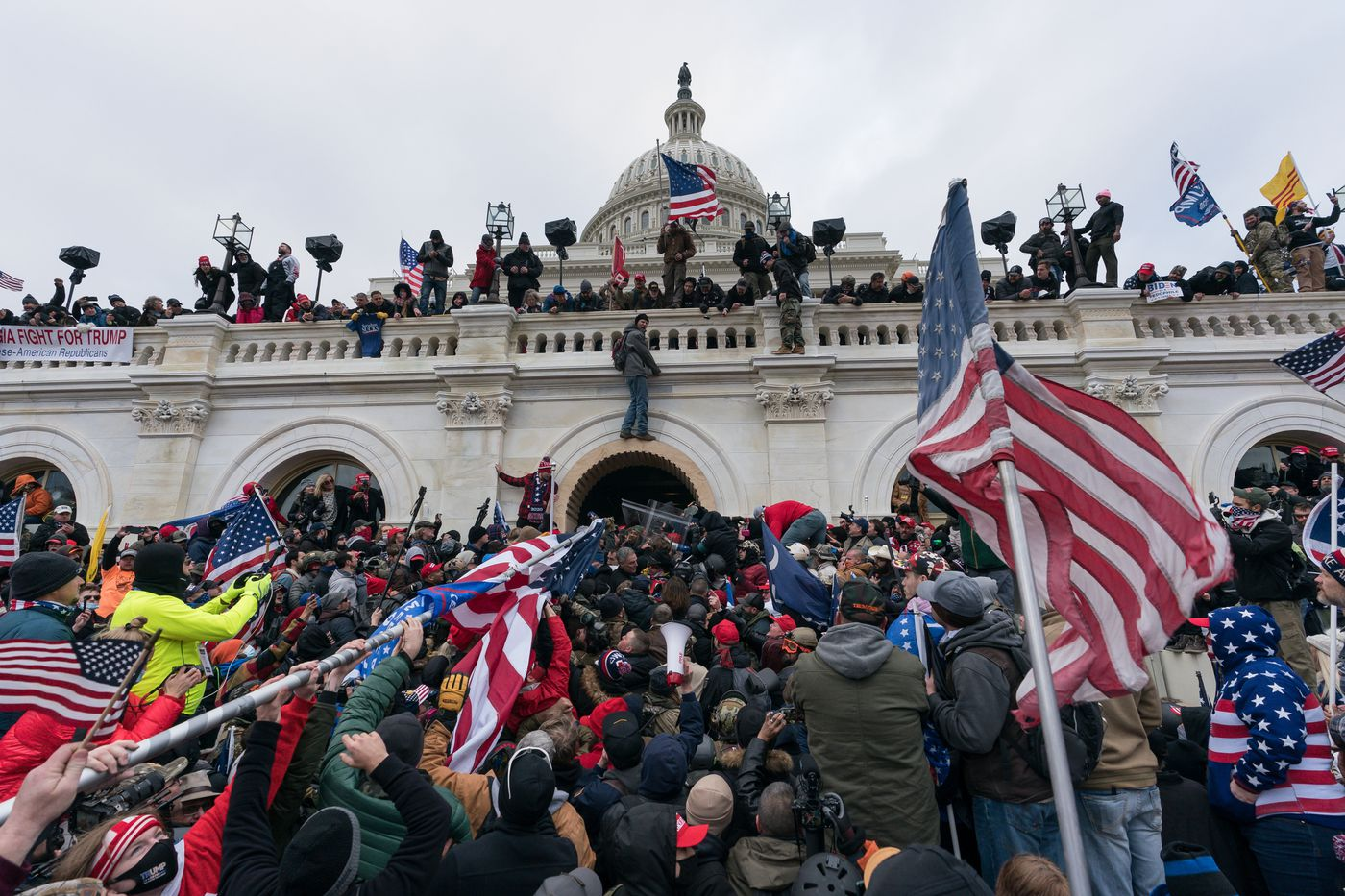 Pro-Trump supporters push back against police at the United States Capitol Building in Washington, D.C. on January 06, 2021.
