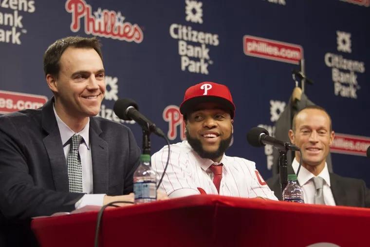 Philadelphia Phillies general manager Matt Klentak (left) with newly-signed first baseman Carlos Santana  (center) and manager Gabe Kapler (right).