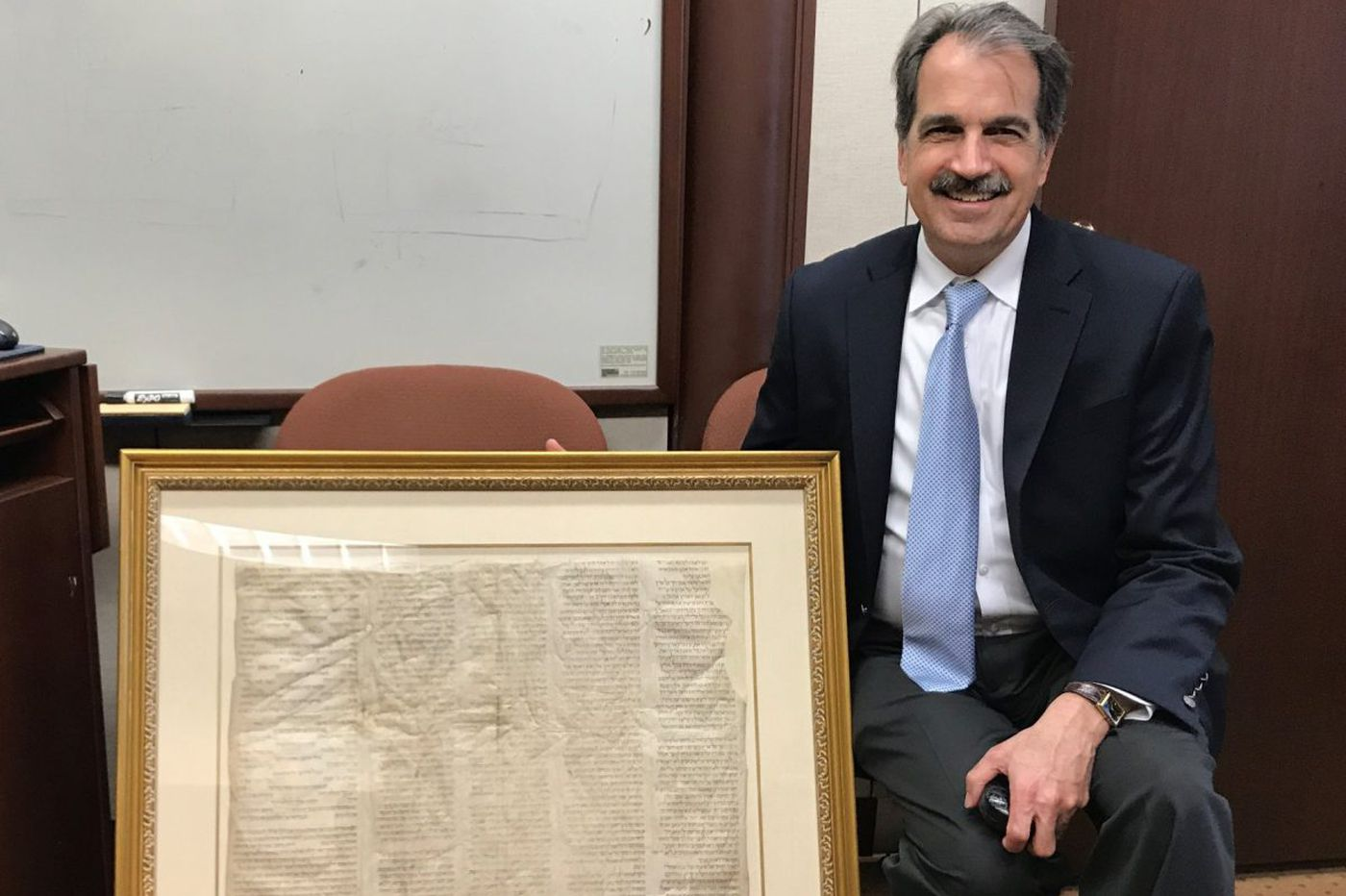 Ancient Torah scroll sheet preserved for public display. A Rutgers professor played a vital role in its acquisition