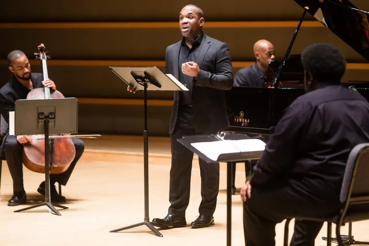 Tenor Lawrence Brownlee sings, with (from left) cellist Khari Joyner, pianist Kevin J. Miller and composer Tyshawn Sorey, at the Feb. 20, 2018 premiere of Cycles of My Being at the Perelman Theater.