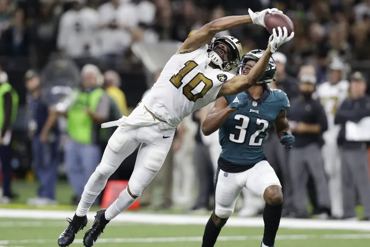 New Orleans Saints wide receiver Tre'Quan Smith catches the football pasts Eagles cornerback Rasul Douglas during the third-quarter on Sunday, November 18, 2018 in New Orleans. Douglas go hurt on the play. YONG KIM / Staff Photographer