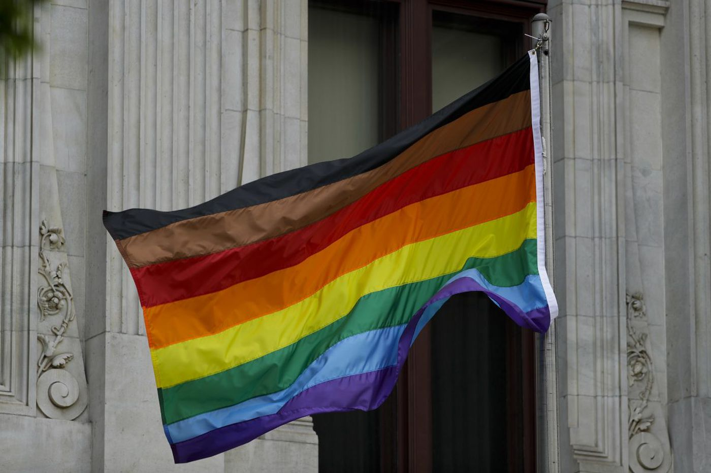 Who gets to decide what belongs on the gay pride flag?