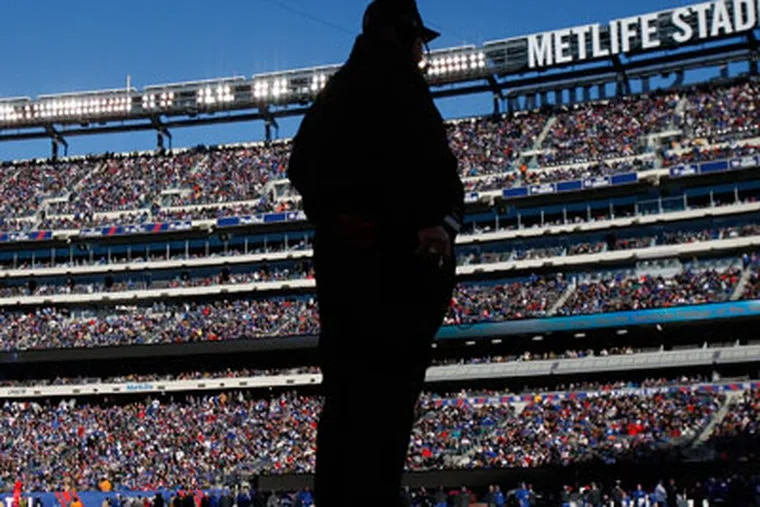 Philadelphia Eagles' head coach Andy Reid watches from the sidelines during the 2nd quarter. Philadelphia Eagles lost to the New York Giants 42-7 at MetLife Stadium in East Rutherford, NJ on December 30, 2012.  (AP Photo/Philadelphia Daily News, David Maialetti)