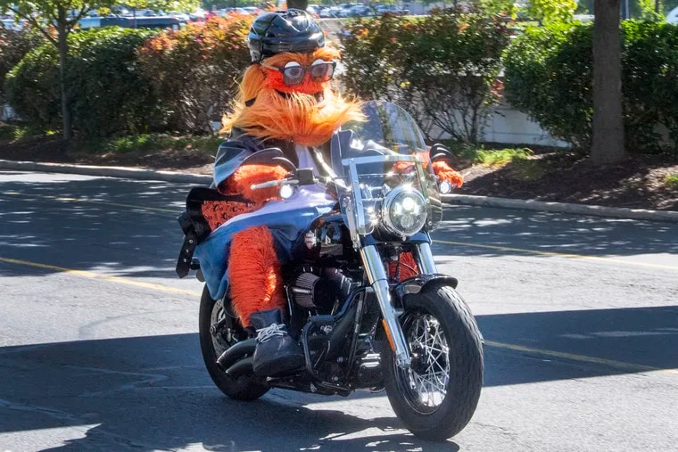 Flyers mascot Gritty takes a motorcycle joy ride in celebration of his birthday on Friday.