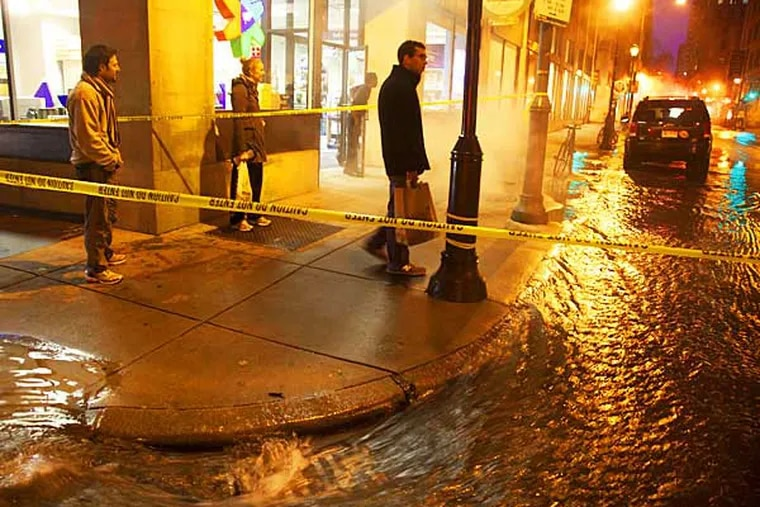 A water main break occured at 16th and Walnut at approximately 4pm Saturday closing the blocks between 16th and 17th with almost a foot of water. ( RYAN S. GREENBERG / Staff Photographer )