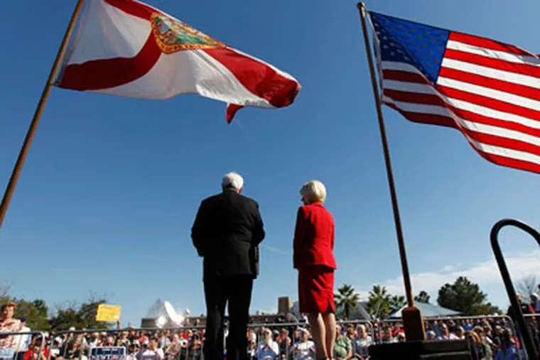 Republican presidential candidate, former House Speaker Newt Gingrich, with his wife Callista, speaks during a campaign event at the The Villages, Sunday, Jan. 29, 2012, in Lady Lake, Fla. (AP Photo/Matt Rourke)