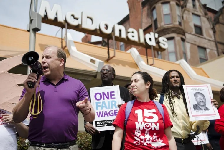 Pennsylvania State Sen. Daylin Leach (D., Montgomery) at a May Day demonstration in 2015 calling for a raise of the minimum wages to $15 an hour.