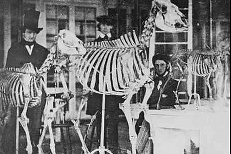 At least two experts believe Edgar Allan Poe is sitting on the right in an 1840s photo taken inside the Academy of Natural Sciences, then on Broad Street. The identities of all three men are in dispute.