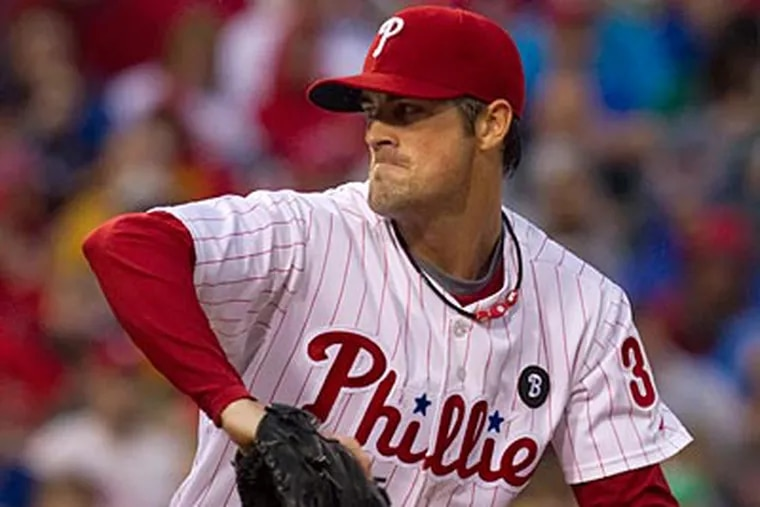 Cole Hamels struck out eight and allowed one run in eight innings against the Rockies. (Ed Hille/Staff Photographer)