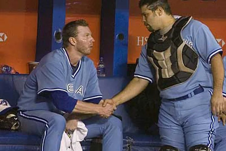 Toronto starting pitcher Roy Halladay, left, shakes hands with catcher Rod Barajas after the Blue Jays lost to the Rays last night. Halladay struck out 10 batters. (AP Photo/The Canadian Press, Chris Young)