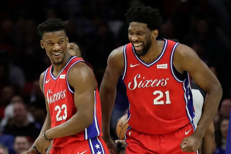 Jimmy Butler (left) played one season with Joel Embiid and the 76ers.