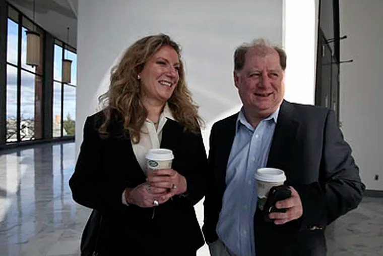 Susan Finkelstein, left, arrives at the Bucks County Courthouse in Doylestown, Bucks County, on Thursday, with her husband, Jack LaVoy, right, to appear on charges she offered sex for World Series tickets in an online ad. (For the Daily News / Joseph Kaczmarek)