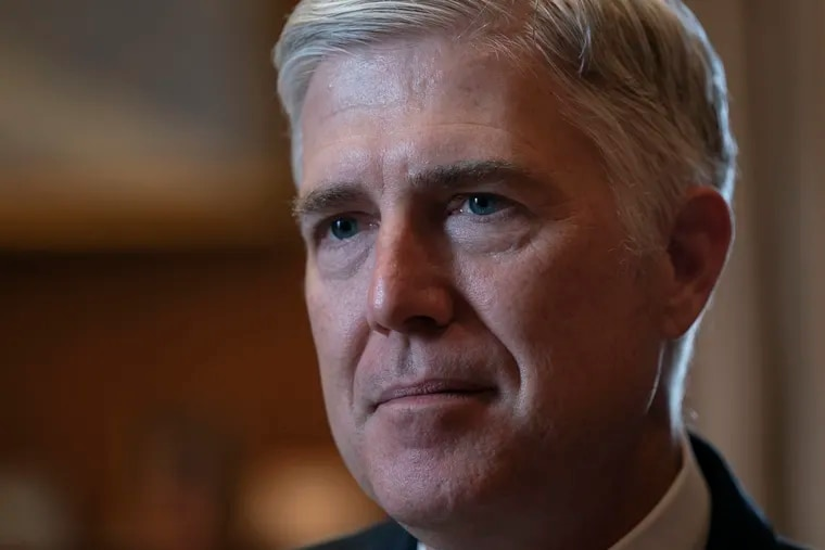Associate Justice Neil Gorsuch, President Donald Trump's first appointee to the high court, speaks to The Associated Press about events that have influenced his life and the loss of civility in public discourse, in his chambers at the Supreme Court in Washington, Wednesday, Sept. 4, 2019. Gorsuch has written a new book on the importance of civics and civility, and a defense of his preferred originalism method of interpreting laws and the Constitution.