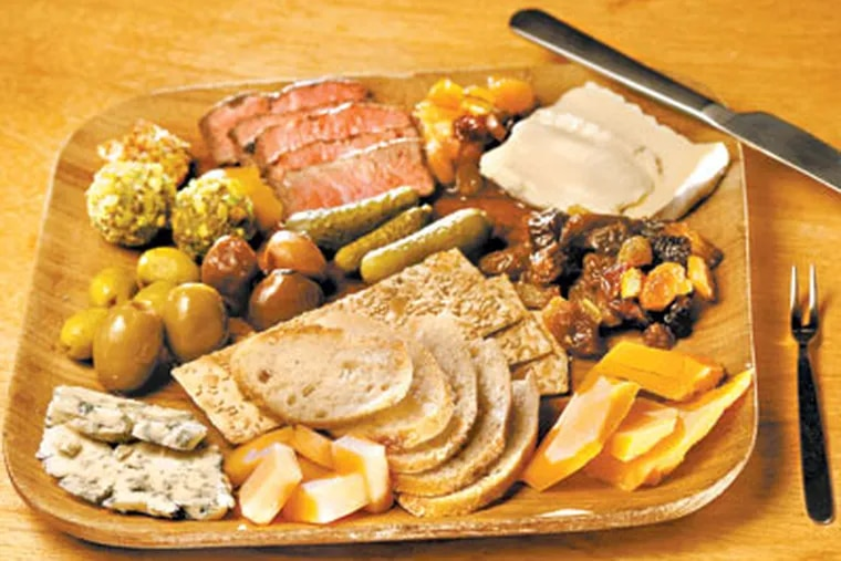 The Farmer's Plate at Sycamore: a choice of three cheeses and two charcuterie items, plus accoutrements. ( Michael S. Wirtz / Staff Photographer )