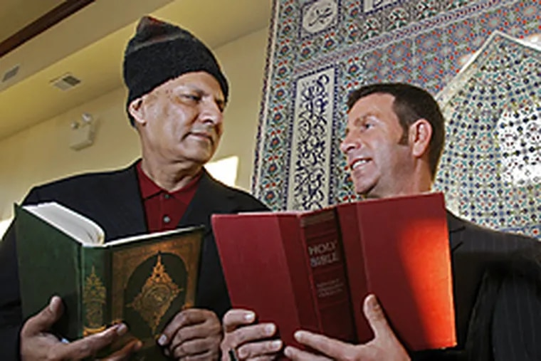 Zia Rahman, left, and Father Joseph Wallace, right discuss the upcoming milestone agreement of understanding and cooperation between their religious communities. (Gerald S. Williams/Inquirer)