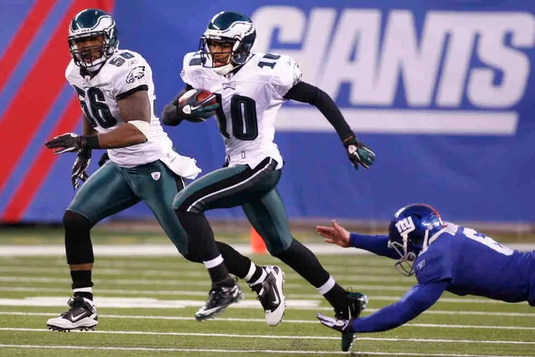 As the clock runs out, DeSean Jackson races away from the Giants' Matt Dodge, who failed to punt the ball out of bounds. The touchdown was the Eagles' fourth straight, overcoming a 31-10 deficit.