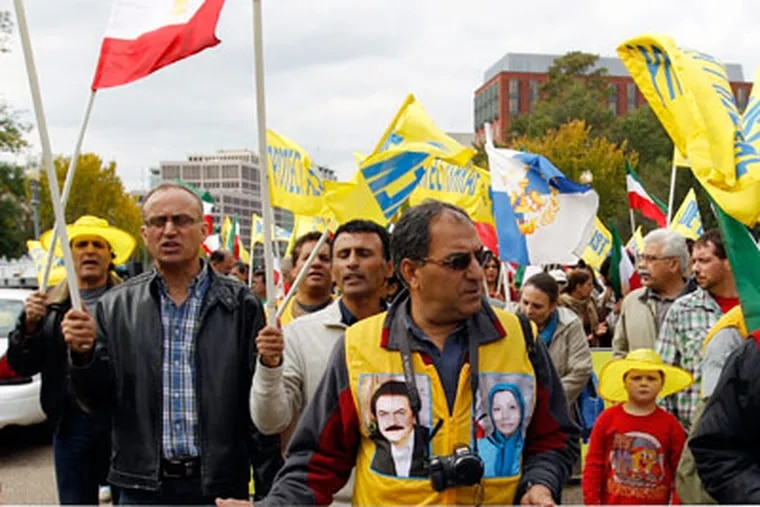 Demonstrators protest near the White House in Washington during a freedom rally in Washington Saturday, Oct. 22,  2011. Hundreds of people rallied in front of the White House, demanding that an Iranian opposition group, Mujahedin-e Khalq (MEK), once allied with Iraq's Saddam Hussein be removed from a U.S. terror list.  (AP Photo/Jose Luis Magana)