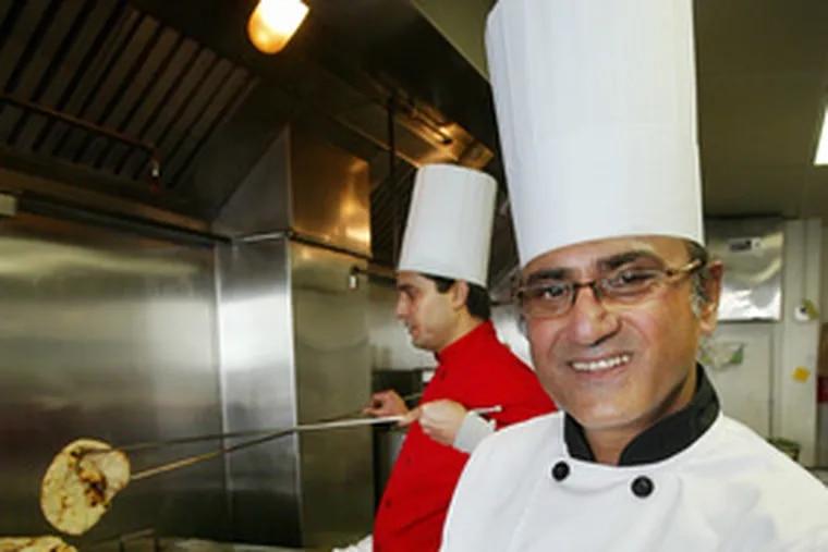 Chef Raju Bhattarai (foreground) and sous chef Bishnu Pokhrel hard at work at Ekta Indian Cuisine.