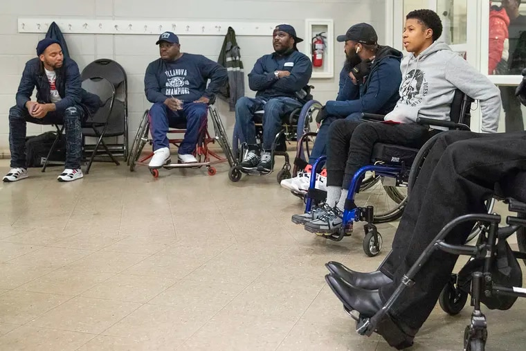 Mykkia McDonald, 24, right, attends the paralyzed gunshot survivors group at the Carousel House in West Philadelphia on Monday evening, Nov. 18, 2019. McDonald attended for the first time, and is the only woman so far to join the group. She was shot 10 times around seven months ago while she was out to get food in North Philadelphia.