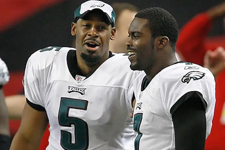 Michael Vick and Donovan McNabb both played key roles in the Eagles' win over the Giants. (Ron Cortes/Staff file photo)