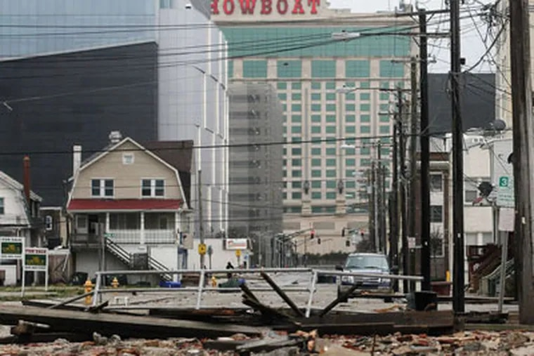 Debris litters an area where a 2,000-foot section of Boardwalk was destroyed in Atlantic City.