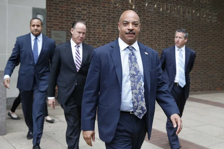Seth Williams, center, leaves after being arraigned on additional charges at federal court in Philadelphia, PA on May 11, 2017.