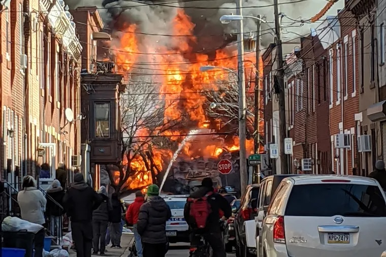 A view of a fire on 8th Street between Dickinson and Reed in Philadelphia on Thursday, Dec. 19, 2019.