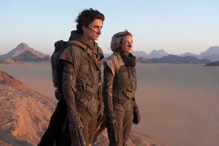 """Timothée Chalamet and Rebecca Ferguson in a scene from the upcoming 2021 film """"Dune."""" The film premiered at the 78th Venice International Film Festival."""