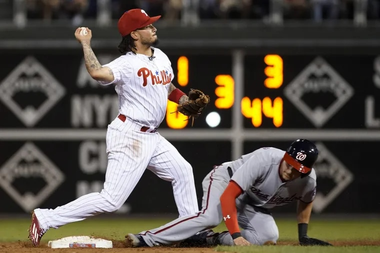 Phillies shortstop Freddy Galvis  throws to first base after forcing out Washington's Trea Turner in September.