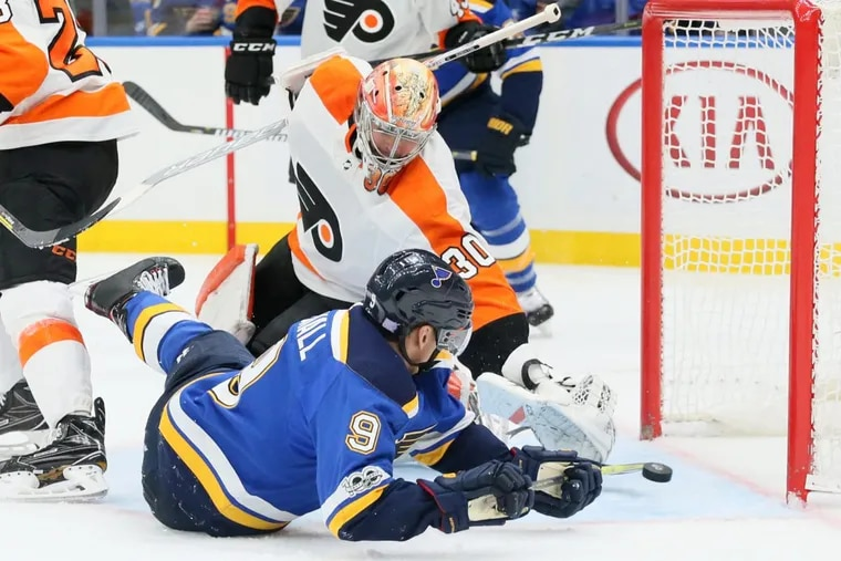 The Blues' Scottie Upshall (9) tries to score against Flyers goaltender Michal Neuvirth in the third period Thursday,.
