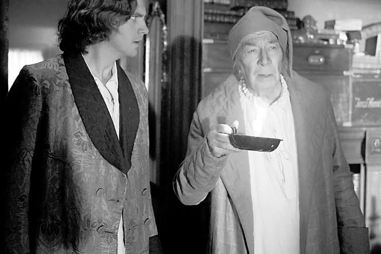 """""""The Man Who Invented Christmas"""": Dan Stevens (left) stars as Charles Dickens, with Christopher Plummer as Ebenezer Scrooge. KERRY BROWN /Bleecker Street"""