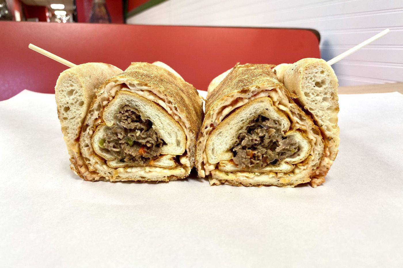 The Philly Taco is cheesesteak wrapped in a slice of pizza. Get it under one roof at Pizza Da'Action on South Street.
