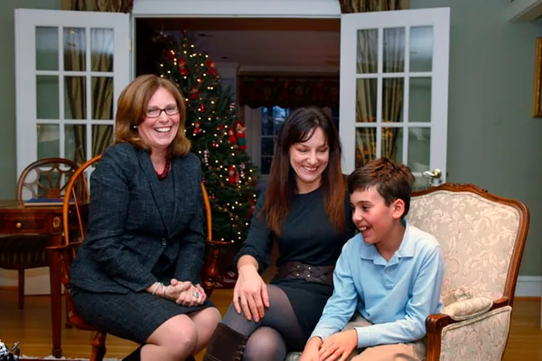 Tracy Siebold (left), an attorney with Ballard Spahr LLP that represents agencies that assist people with autism, visits with Amelia Carolla (center) and her son Ben Bono (right), 11, a student with autism. 12/04/12. ( Michael S. Wirtz / Staff Photographer )