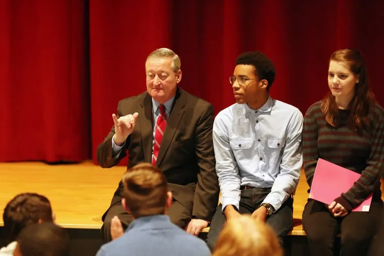 Mayor Kenney sits with students Justice Passe and Megan Davis at Lincoln High School.