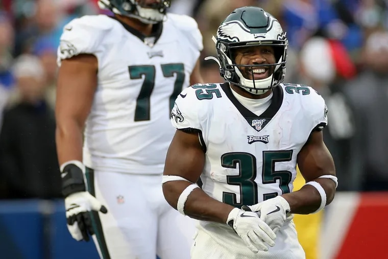 Eagles running back Boston Scott smiles after scoring a touchdown  against the Bills.