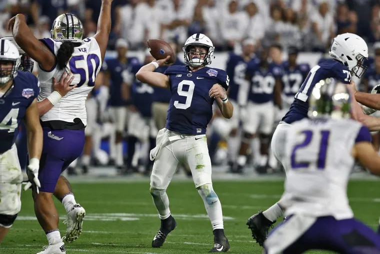 Penn State quarterback Trace McSorley (center) throws against Washington during the second half of the Fiesta Bowl NCAA college football game, Saturday, Dec. 30, 2017, in Glendale, Ariz.