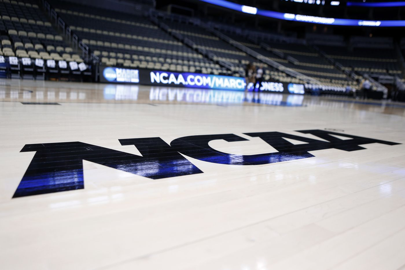 The NCAA logo is on the court at The Consol Energy Center in Pittsburgh.