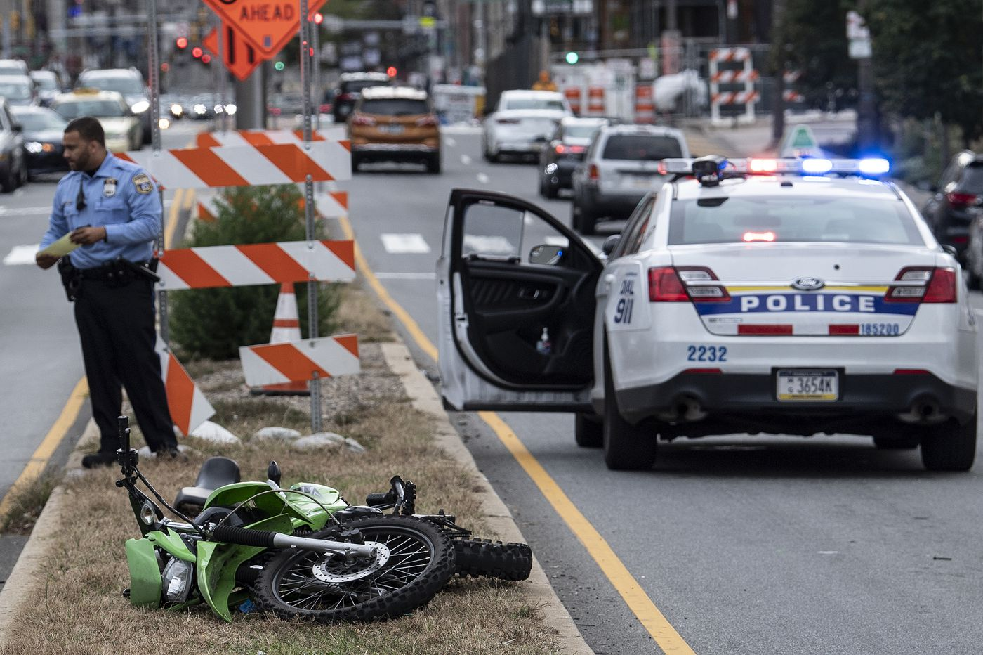 Police car struck by dirt bike, injuring officer