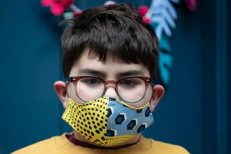 Milo Driscoll, 9, posed for a portrait in his mask outside of his home in the Passyunk Square neighborhood in Philadelphia, Pa. on Friday, April 17, 2020.