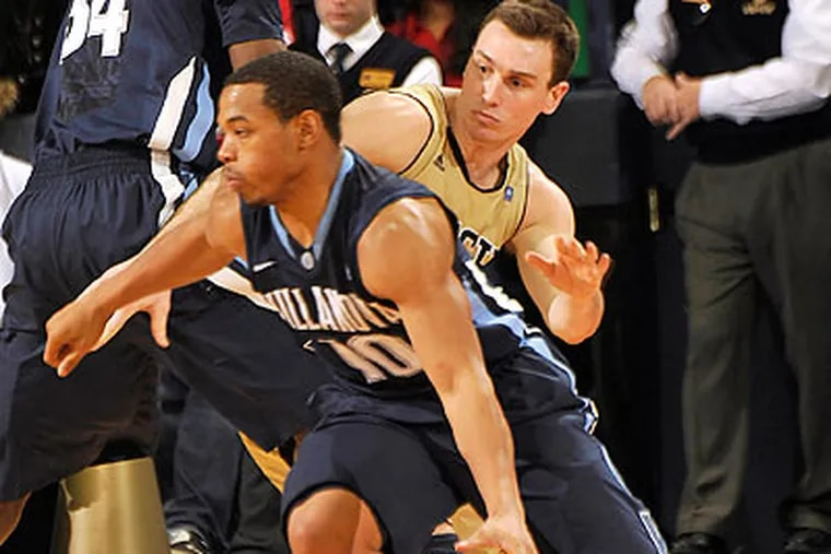 Corey Fisher led Villanova with 22 points, but 15 of them came in the final seven minutes of the game. (Joe Raymond/AP)