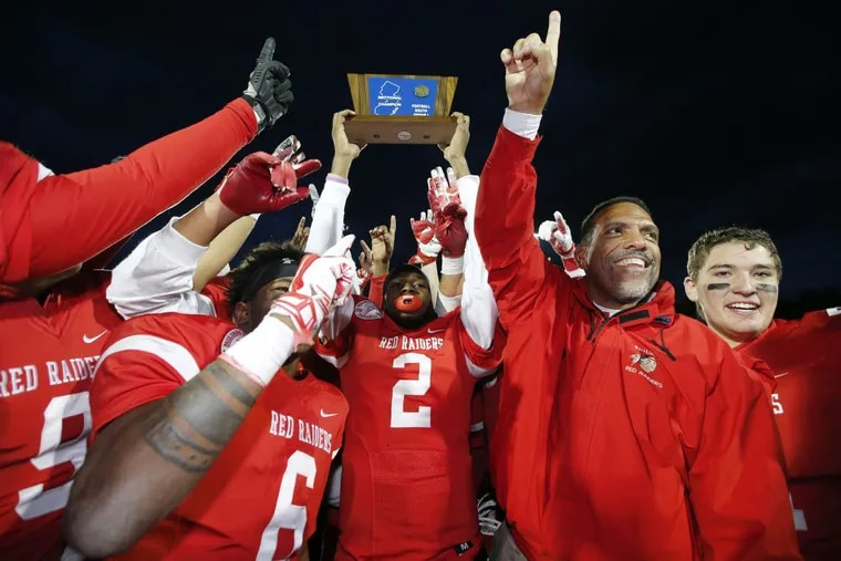 Coach Glenn Howard and Paulsboro celebrated after beating Salem 29-26 in last year's South Jersey Group 1 title game.