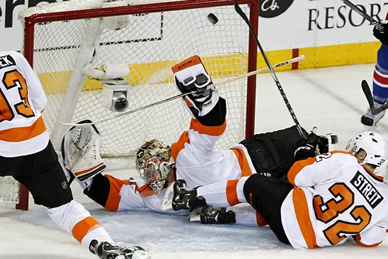 Flyers goalie Steve Mason allows a goal against the Rangers during Game 5 on Sunday at Madison Square Garden. (Ron Cortes/Staff Photographer)