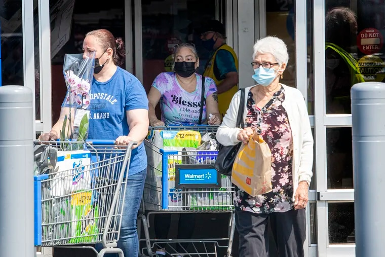 Shoppers exit a Walmart store in Philadelphia while wearing face masks on Wednesday, August 11.
