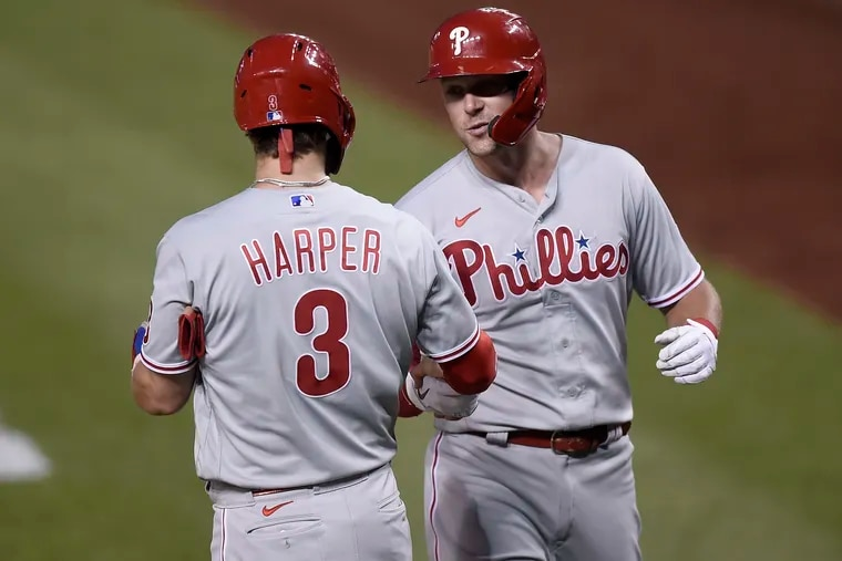 Phillies first baseman Rhys Hoskins celebrates with Bryce Harper after hitting a two-run home run in the fifth inning of Wednesday night's 9-5 victory over the Washington Nationals.