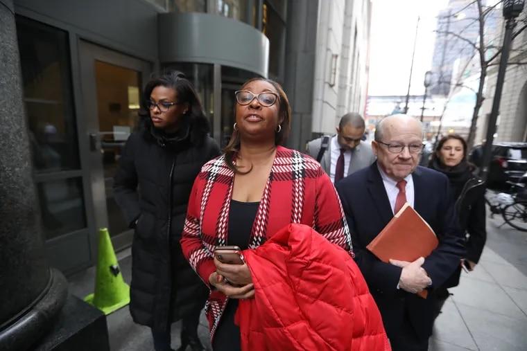 Desiree Peterkin Bell leaves the Criminal Justice Center Thursday, January 2019. DAVID SWANSON / Staff Photographer