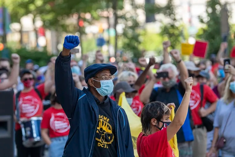 Protesters gather during a Labor Day rally at Philadelphia City Hall.