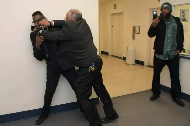 Black Lives Matter leader Asa Khalif is shown being detained at the US Attorney's office in Center City on 600 block of Chestnut St., Philadelphia, Monday, November 13, 2017.