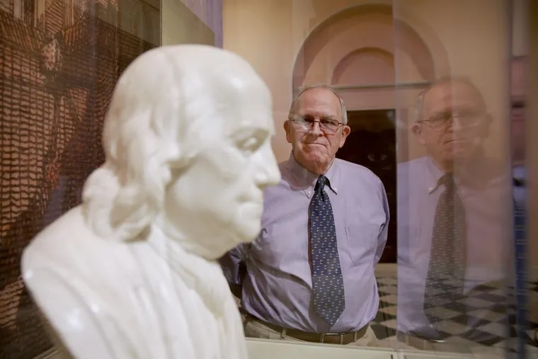 Bob Giannini stands next to a bust of Benjamin Franklin inside the portrait gallery at the Second Bank of the United States. Decades ago, Giannini helped transport the bust, a gift to the museum, from the Main Line in the back of a station wagon.